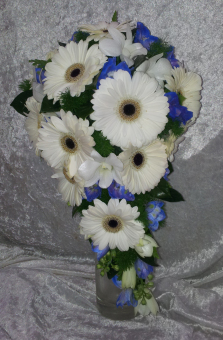 A Trailing Bouquet of White Mini Gerberas with Blue Delphinium