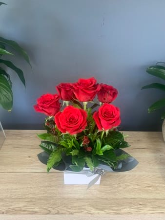 Rose Arrangement Half Dozen Red In Ceramic Pot